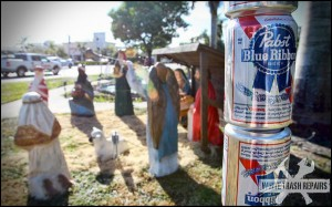 PBR 'Festivus' pole next to Nativity – White Trash Repairs